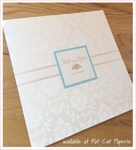 Nicole + Robert | Celebrating July | Ivory and gold invitation with aqua accents, designed and printed by Arabella