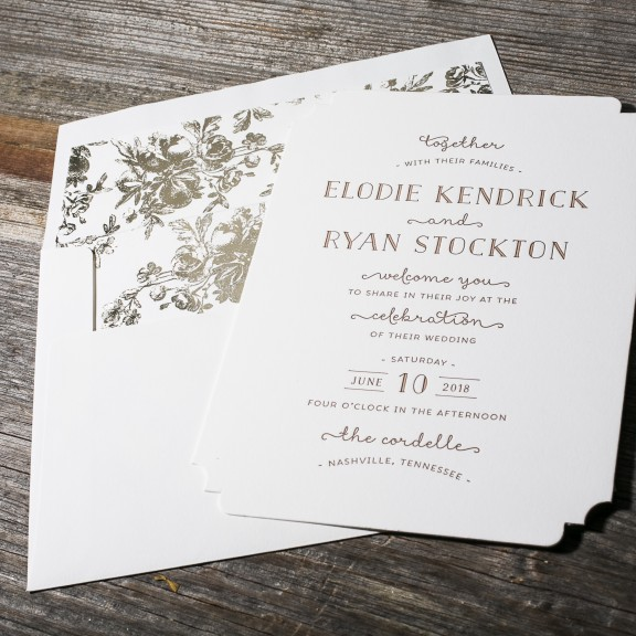 Elodie by BellaFigura, whimsical typeset invitation with foil floral patterned envelope liner