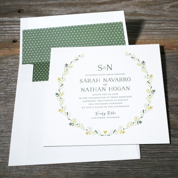 Chaplet by Bella Figura, whimsical illustrated floral wreath wedding invitation, green color palette, letterpress and digital printing, Hand drawn style fonts, monogram with ampersand , green and white polka dot envelope liner