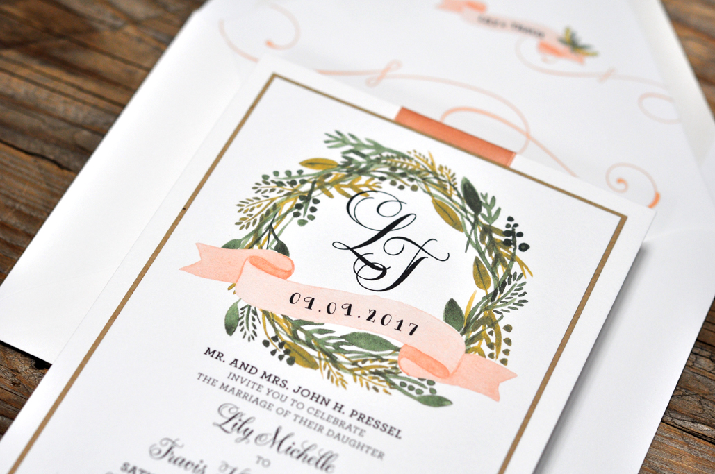 Lily by BTElements, Rustic and whimsical wedding invitation with greenery wreath detail around monogram, Layered card with white and kraft papers and pink ribbon, Whimsical calligraphy style fonts and printed envelope liner