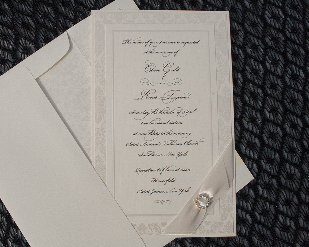 Elissa+Rene, Ivory wedding invitation with crystal brooch and ribbon