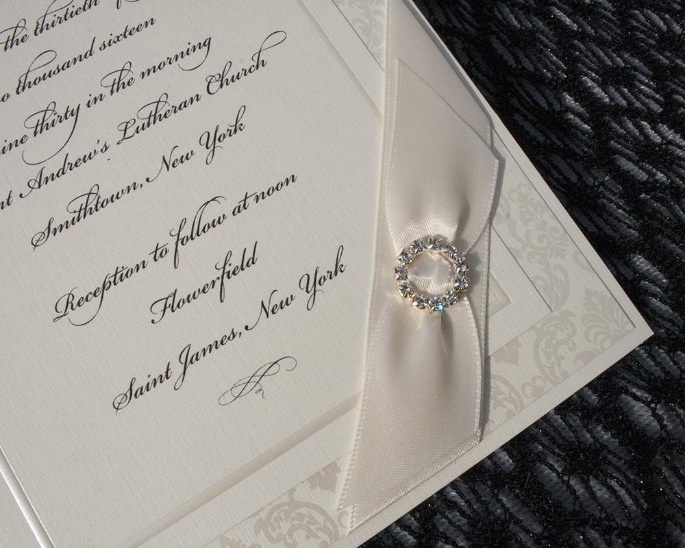 Elissa+Rene, Ivory wedding invitation with crystal brooch and ribbon