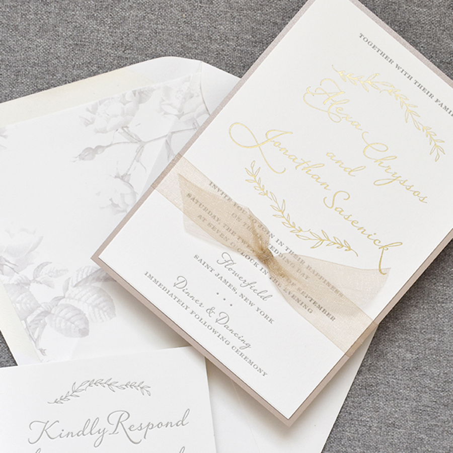 Rustic Gold Foil Wedding Invitation, leaves in gold foil with names in a whimsical script typeface, taupe letterpress text, taupe sheer ribbon and shimmer taupe backing layer, floral envelope liner