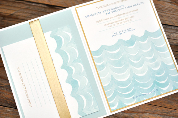 Charlotte by BTElements, Beach theme watercolor waves invitation, Pocket folder with soft gold ribbon detail, whimsical fonts, blue gold and white color palette, digital printing
