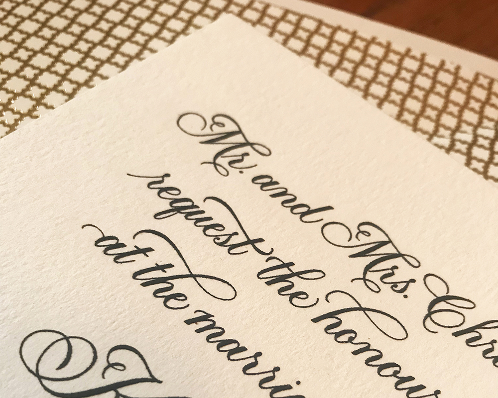 traditional wedding invitation with hand calligraphy, gold envelope liner, black and white design