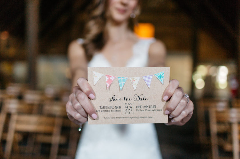 Rustic save the date on kraft paper, bunting, sewn details, whimsical fonts