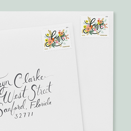"""Rifle Paper Postage Stamps, Floral design with """"love"""" lettering"""