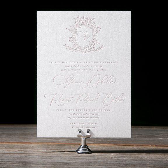 Elegant, whimsical wedding invitation, foil and letterpress, blush tones, monogram crest with floral flourish, spring wedding inspiration
