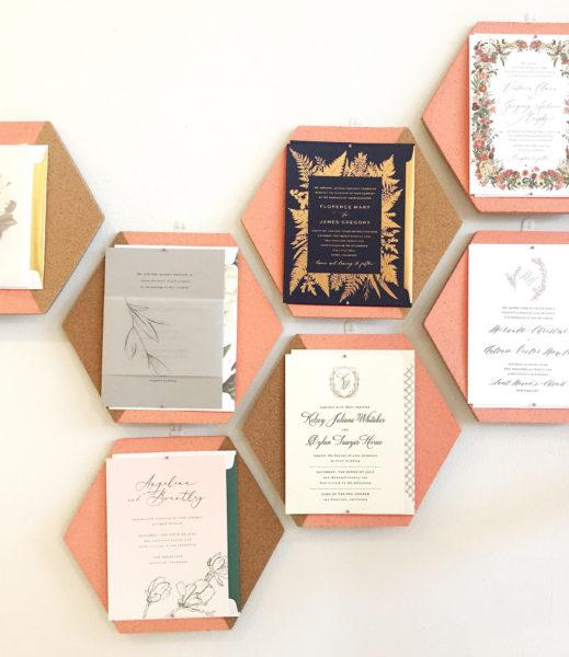 Invitation display at Bella Figura, honeycomb wall display of wedding invitations