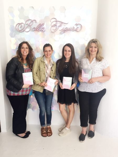 Fat Cat Team at Bella Figura, posing in front of silver foil, honeycomb wall display