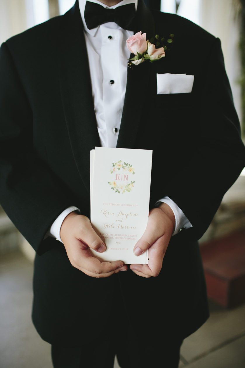 Floral Ceremony Program, linen paper with gold and coral details, floral monogram in pink, green and peach tones