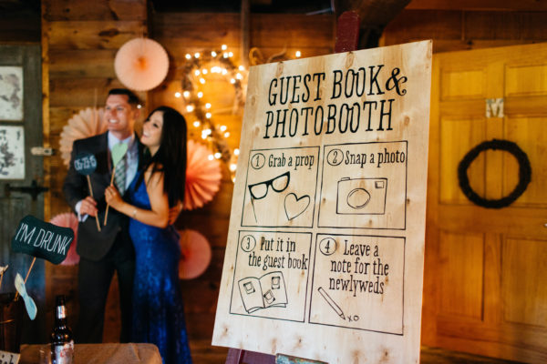 Rustic Guest Book Sign, Black Calligraphy and Illustrations on wooden board, couple posing with phonebook props