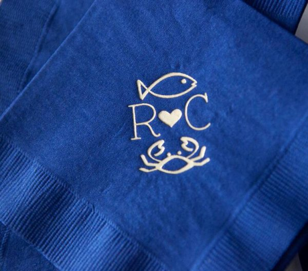Nautical Cocktail Napkins, fish and crab monogram in gold foil on a navy napkin, wedding details