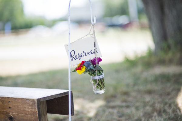 Rustic Reserved Sign, Black text on wood with wildflowers in a mason jar