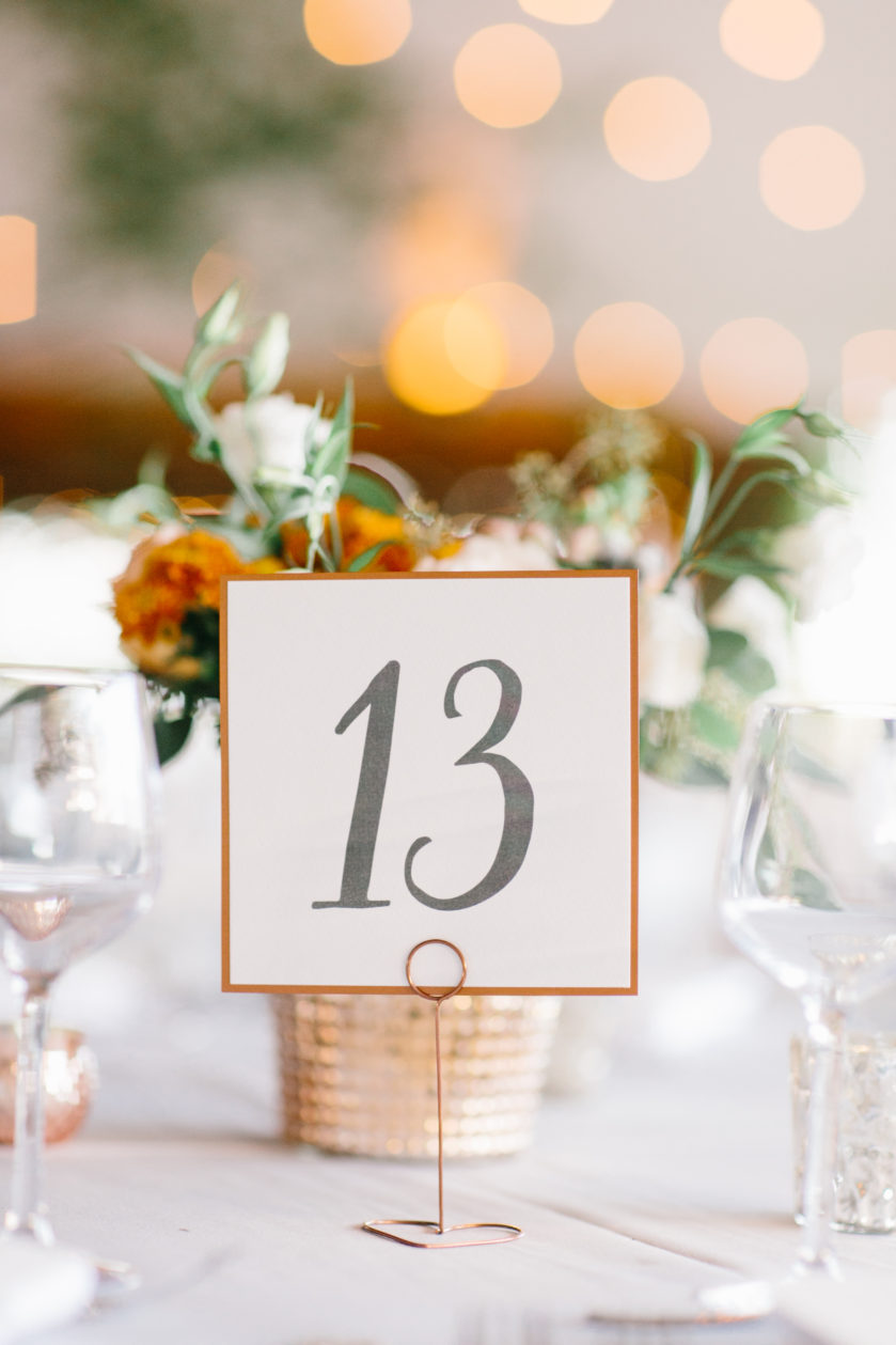 Rustic Table Number, Copper and Gray color palette, copper border with ivory paper, golden lights in the background