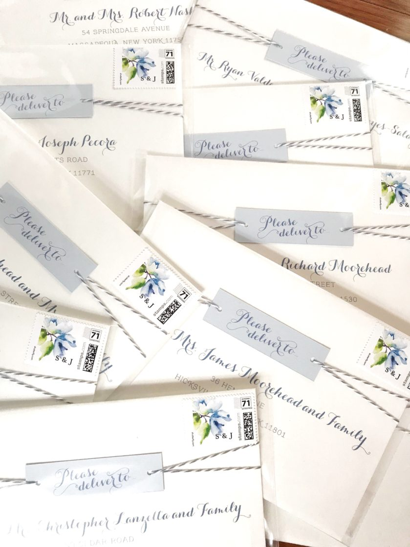 Twine Wedding Invitation, Whimsical mailing envelopes with twine and tag detail, white and light blue with custom monogram stamp