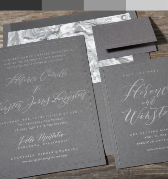 Gray and silver wedding invitation with marble envelope liner and bold gray envelope. Modern fonts including a calligraphy style script.