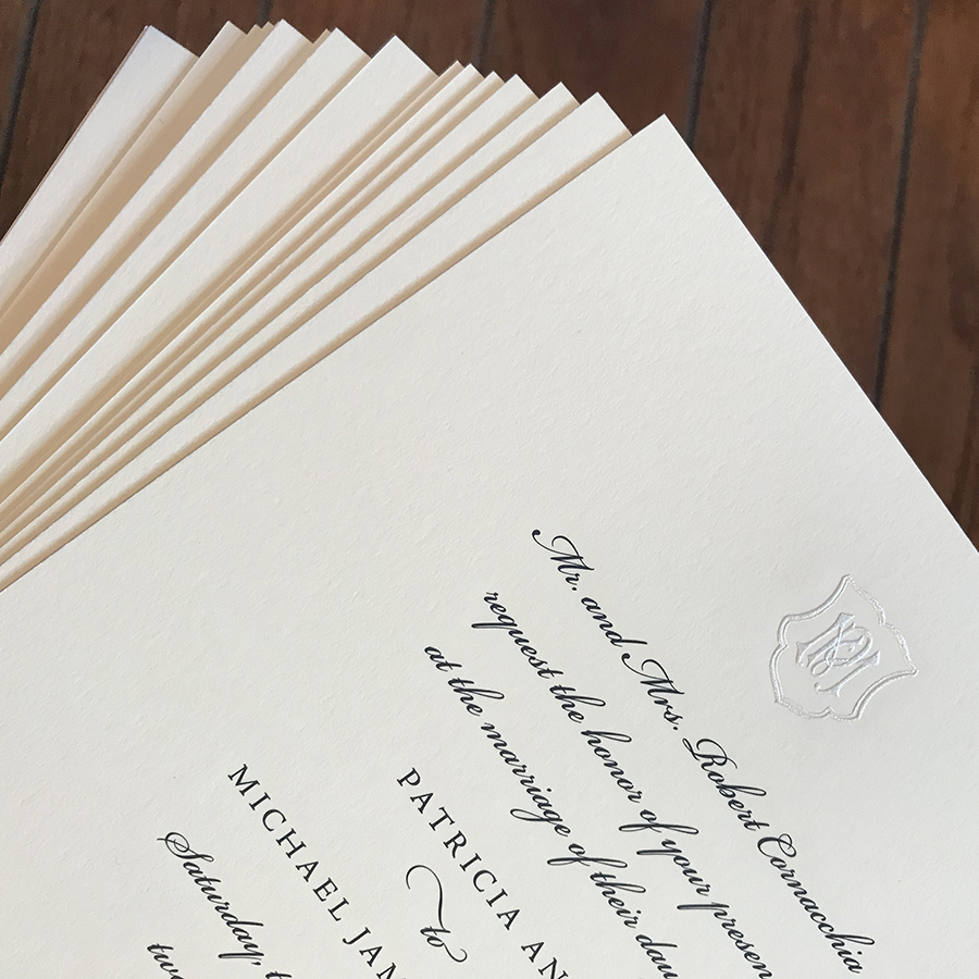 Classic Engraved Wedding Invitation, Black and ivory color palette, monogram crest, traditional style