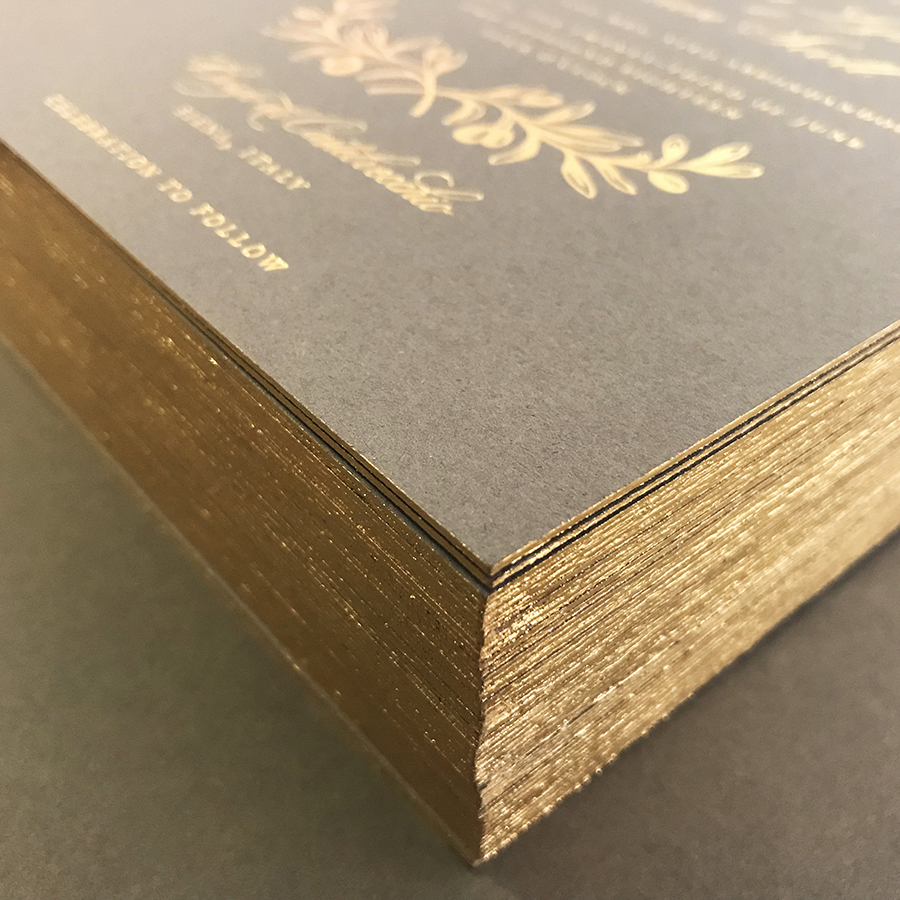 Gold Painted Invitation Edges, Stack of gray invitation with gold edging