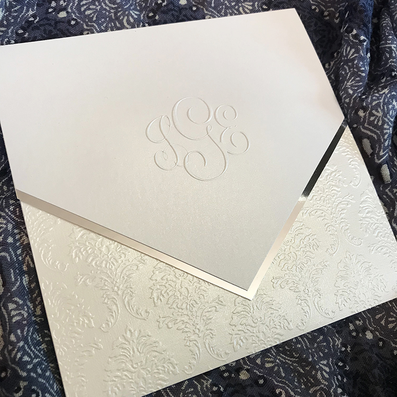 Monogram Pocket Invitation, Silver and white foil and pearlized papers, shimmer paper, decorative monogram embossed on cover