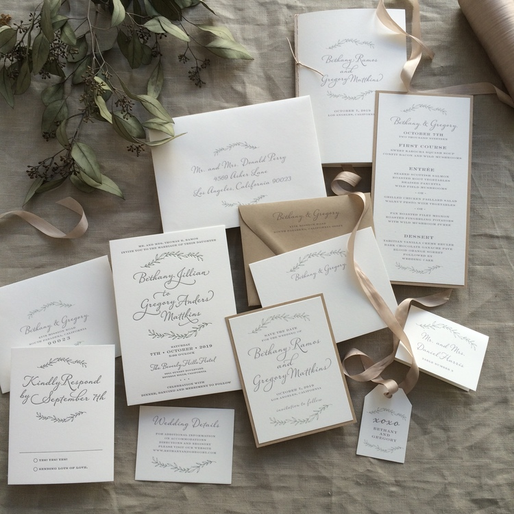 Rustic Letterpress Invitation Suite, kraft envelopes and greenery illustration details