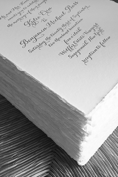 Letterpress invitations with hand torn edges