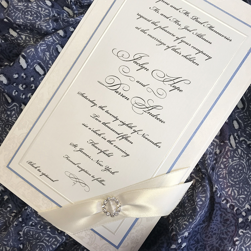 Blue, white, and gray color palette, formal style with ribbon and crystal buckle